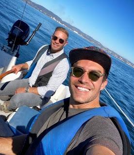 Jacob Jules Villere & Peter Porte clicking selfie in a boat