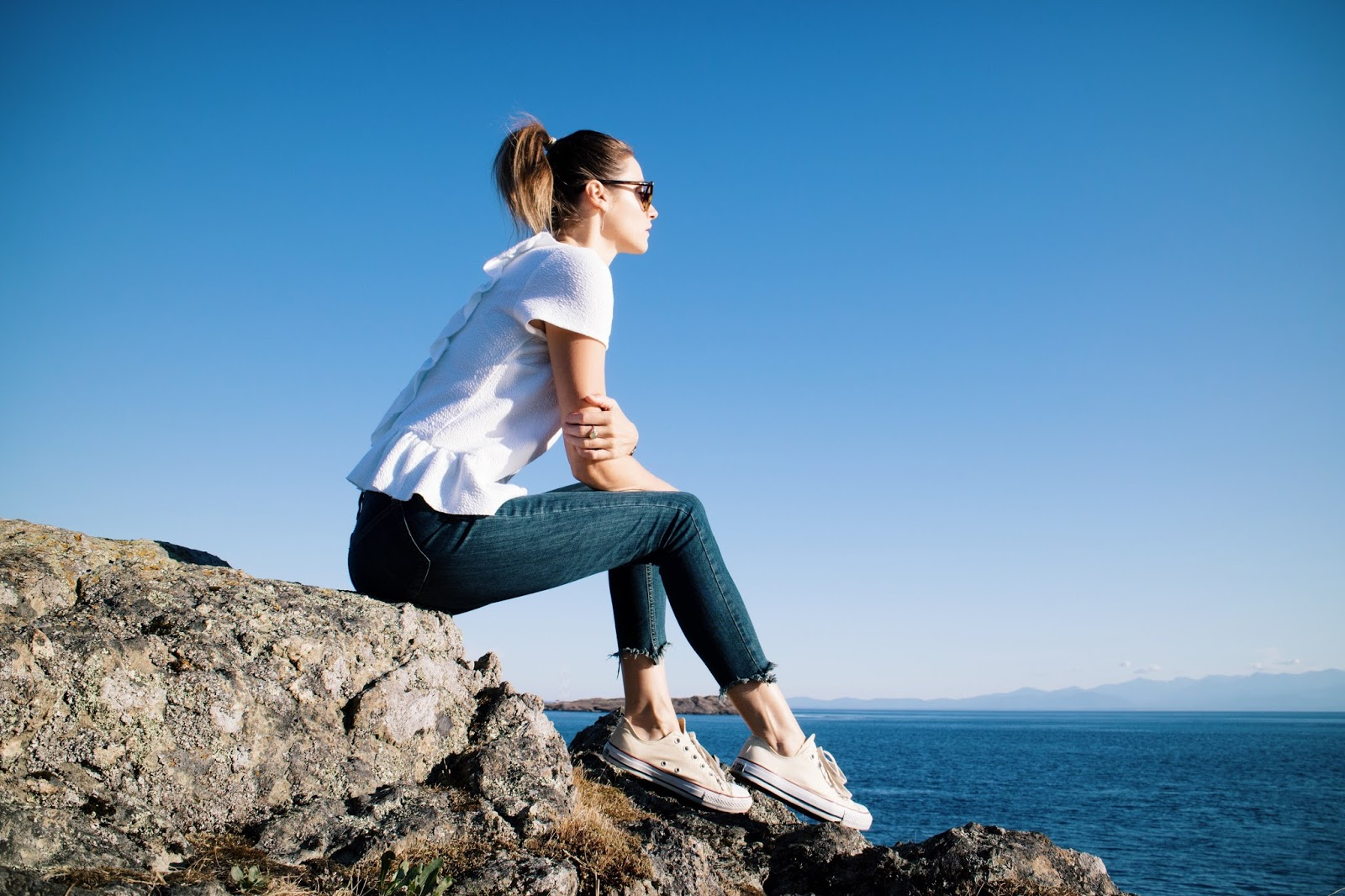 fashion and travel blogger, Alison Hutchinson, at a beautiful view in Victoria, BC