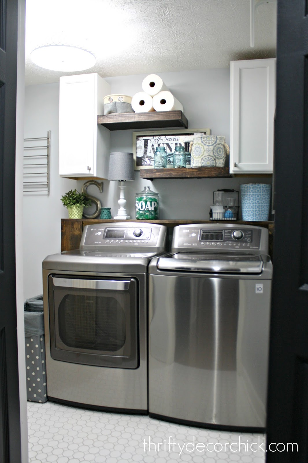 DIY wood shelves above washer and dryer