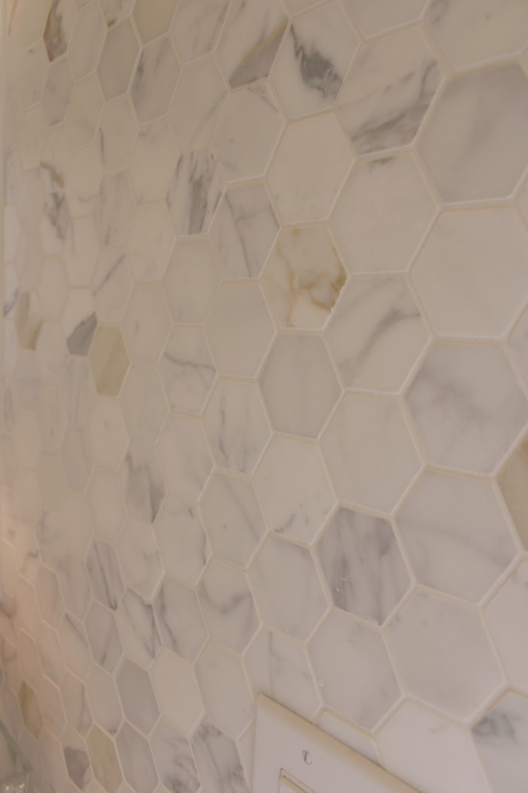 Detail of Calacatta Gold marble hex mosaic tile at Hello Lovely Arizona kitchen
