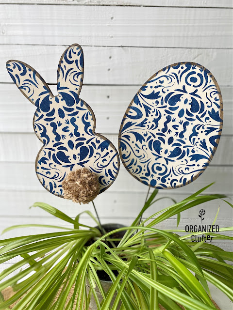 Photo of painted & stenciled bunny & egg shapes on stakes