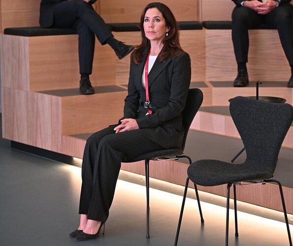 Healthcare Denmark. dark grey pinstripe belted blazer, pinstripe blazer pants suit. Crown Princess Mary wore a drop earrings from Marianne Dulong