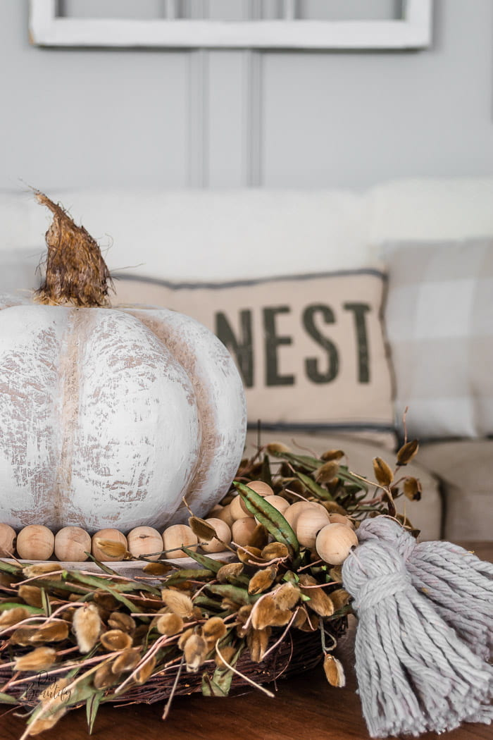pumpkin centerpiece with pussy willow wreath, beaded garland and farmhouse white pumpkin