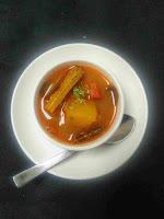 Serving hot sambar in a bowl for medu vada