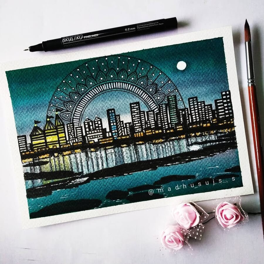 05-City-skyline-and-a-full-moon-Madhusuja-www-designstack-co