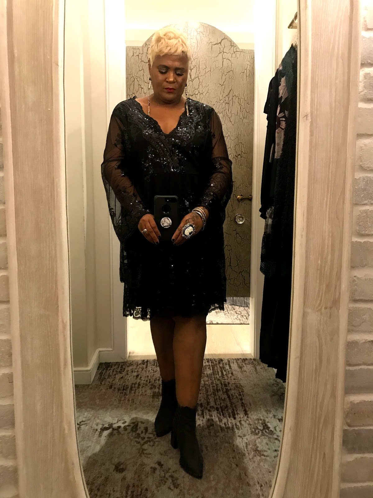 Tangie Bell trying on a really cute lace black dress