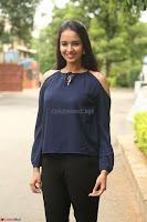 Poojita Super Cute Smile in Blue Top black Trousers at Darsakudu press meet ~ Celebrities Galleries 032.JPG