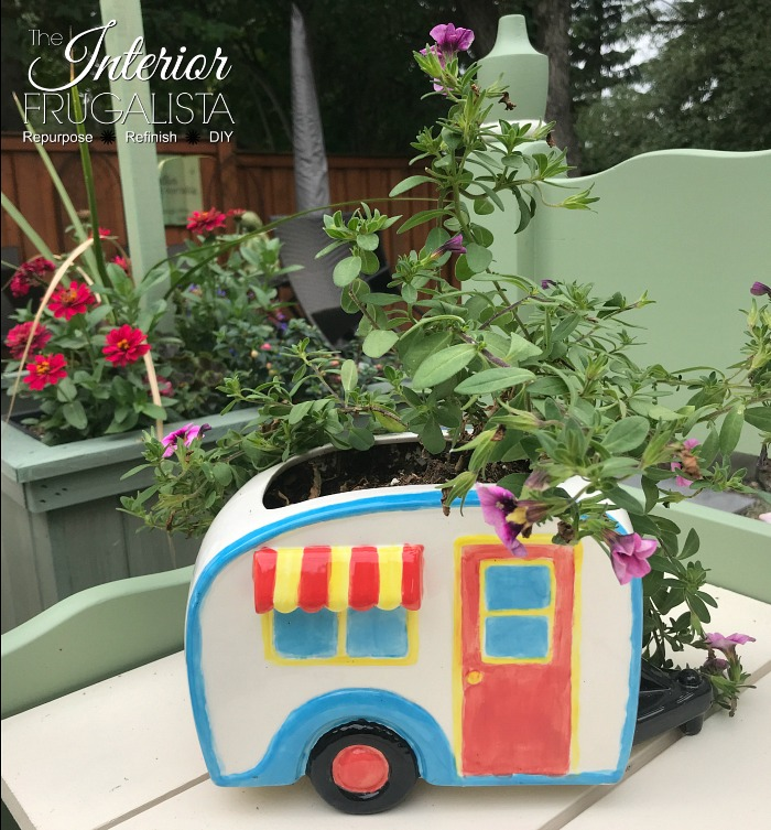 How to rejuvenate weathered metal garden art with whimsical charm. An easy budget-friendly yard art upcycle rather than replacing them with brand new.