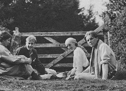 two men and two women sitting on the grass, pre WWI era