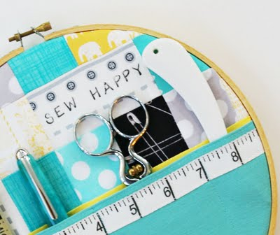 this sewing happy embroidery hoop art is a perfect way to store sewing supplies