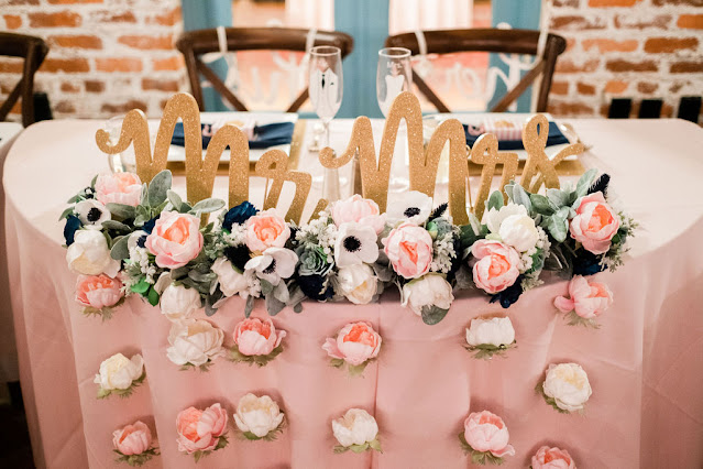 sweetheart table decor with mr. and mrs. signs