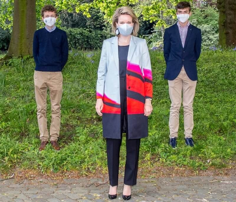 Queen Mathilde wore a new richy silk printed pattern coat from Dries Van Noten