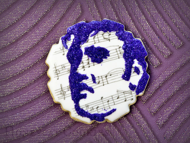 Hand drawn musical notation and Elvis face cookie and photo by Honeycat Cookies