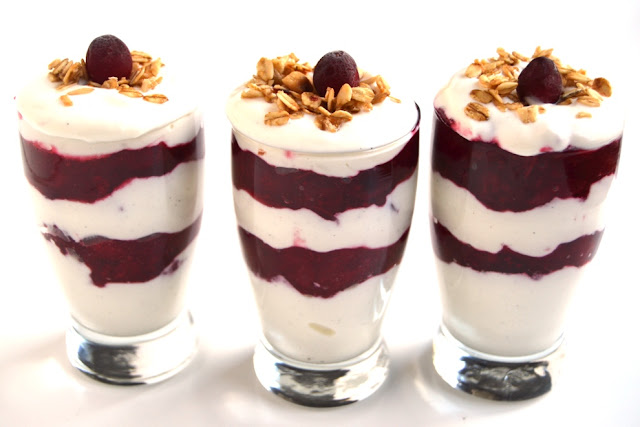 Cranberry Greek Yogurt Parfaits are full of flavor with fresh cranberry sauce, protein-packed Greek yogurt and crunchy granola for the perfect breakfast! www.nutritionistreviews.com