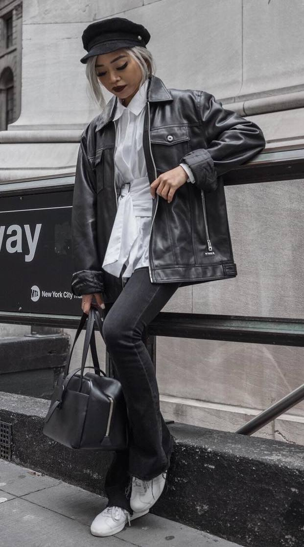 street style addict / oversized leather jacket + bag + hat + jeans + white top + sneakers