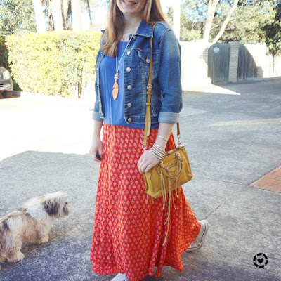 awayfromblue instagram denim jacket red boho print maxi skirt converse yellow bag