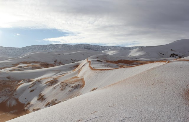 As snow falls extraordinarily in the world's hot lands