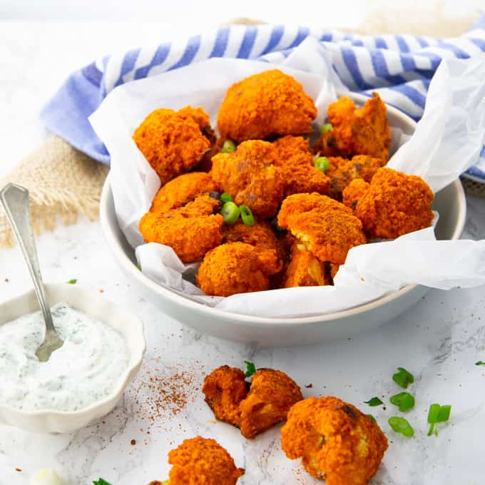 These cauliflower buffalo wings with vegan ranch dip are the perfect comfort food! They're super easy to make and they're soooo delicious! We simply can't get enough of them!
