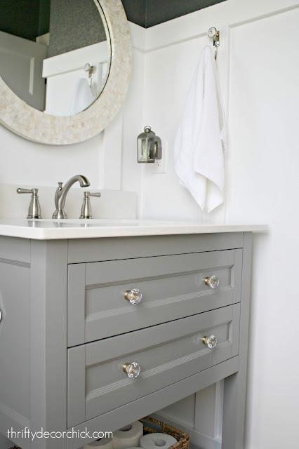Glass knobs gray vanity round mirror bathroom
