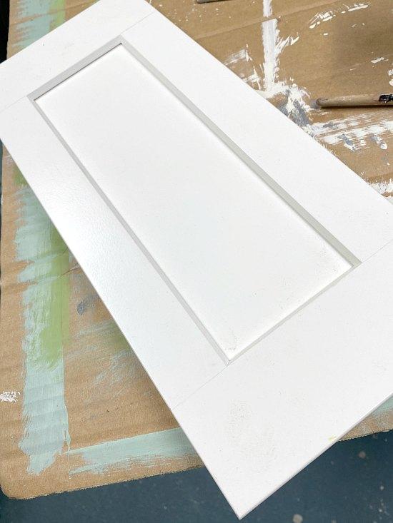 DIY repurposed cabinet door sign