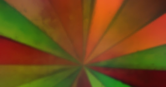 Blur polygon background with crazy green to red field effect.