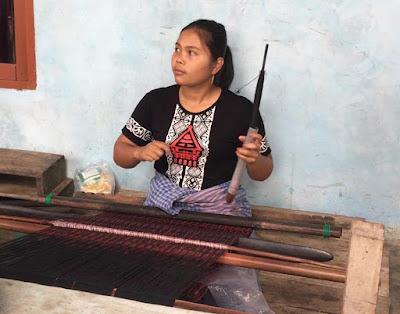 weaver uses a backstrap loom Sibandang Island