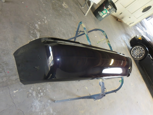 Customer supplied bumper after to paint at Almost Everything Auto Body.