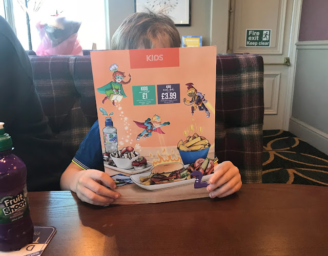 Reading the kids menu at The Highwayman pub Gateshead