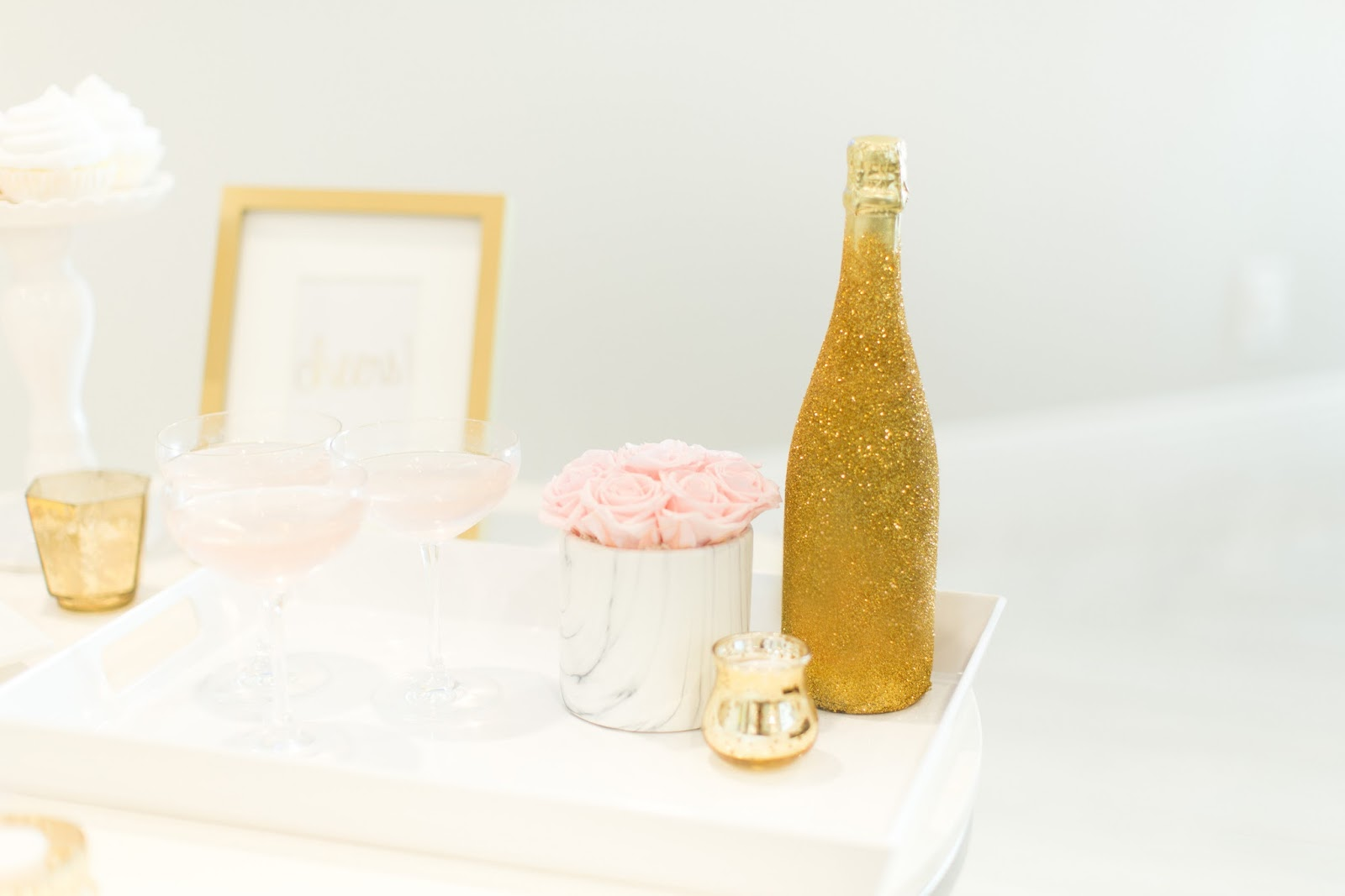 DIY Glitter Champagne Bottle featured by popular Florida party planning blogger, The Celebration Stylist