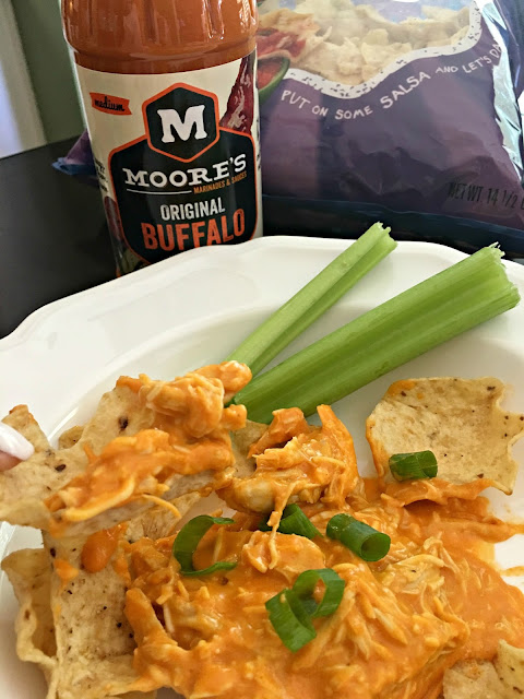 Crockpot Hot Wing Dip is a simple recipe with tons of flavor. I only use Moore's Original Buffalo Wing Sauce to add flavor and spicy. Serve it on sandwiches buns or over tortilla chips at your next party, summer barbecue, or on game night. It reheats great and tastes delicious with a cold beer.