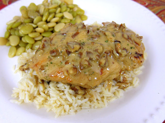 Toasted Pecan Chicken Recipe - pan seared chicken simmered in a creamy orange dijon sauce and toasted pecans. AMAZING flavor! Only takes 20 minutes from start to finish - no prep work. I am going to double the sauce next time so I can pour it over the rice. YUM!