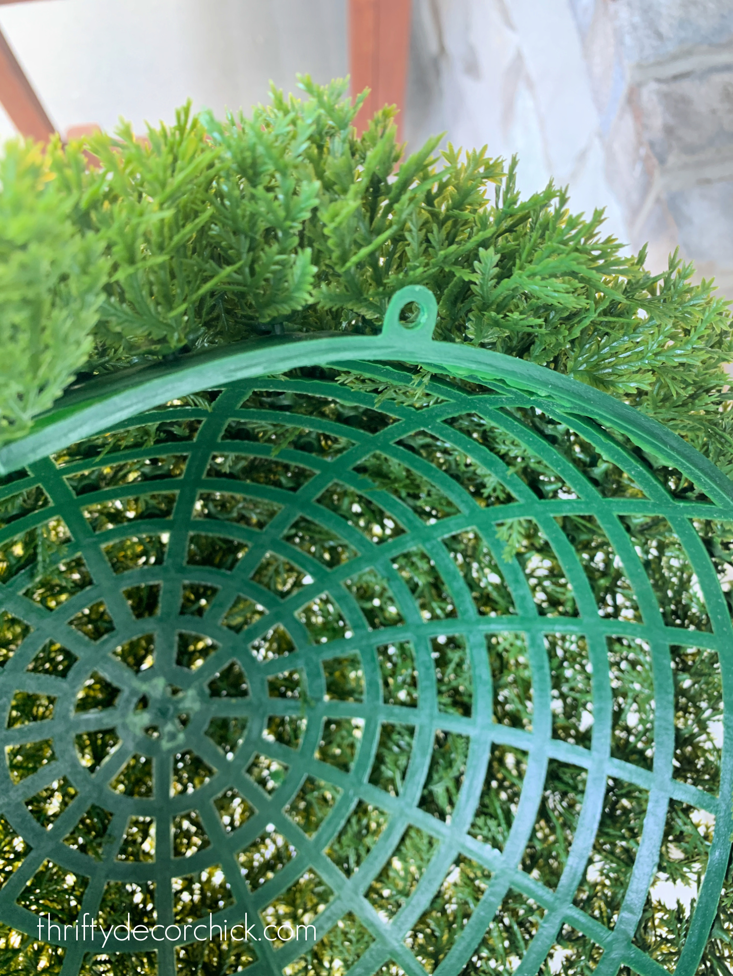 separate fake topiary ball