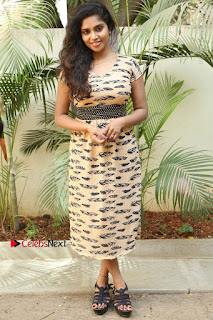 Telugu Actress Karunya Chowdary Stills in Short Dress at ATM Not Working Press Meet  0301.jpg