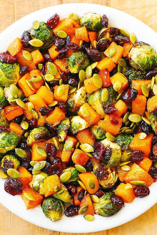 ROASTED BRUSSELS SPROUTS SALAD WITH MAPLE BUTTERNUT SQUASH, PUMPKIN SEEDS, AND CRANBERRIES