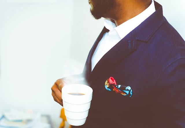 Elegant Business man having a cup of coffee