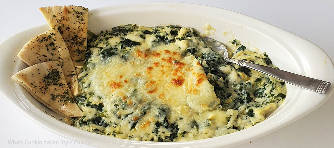 this is an oval white dish that has baked artichoke and spinach dip in it