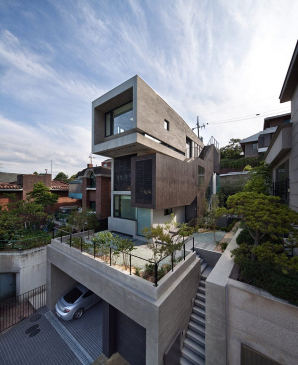 Hogares frescos tres enormes niveles en residencia for Casa minimalista tres pisos