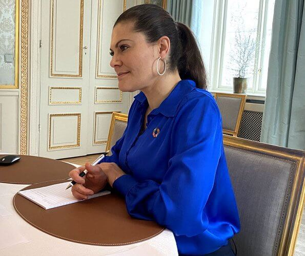 Crown Princess Victoria wore a damen jacket from Houdini, royal blue silk shirt from by Malina, HM, and gold diamonds earrings from LWL Jewelry