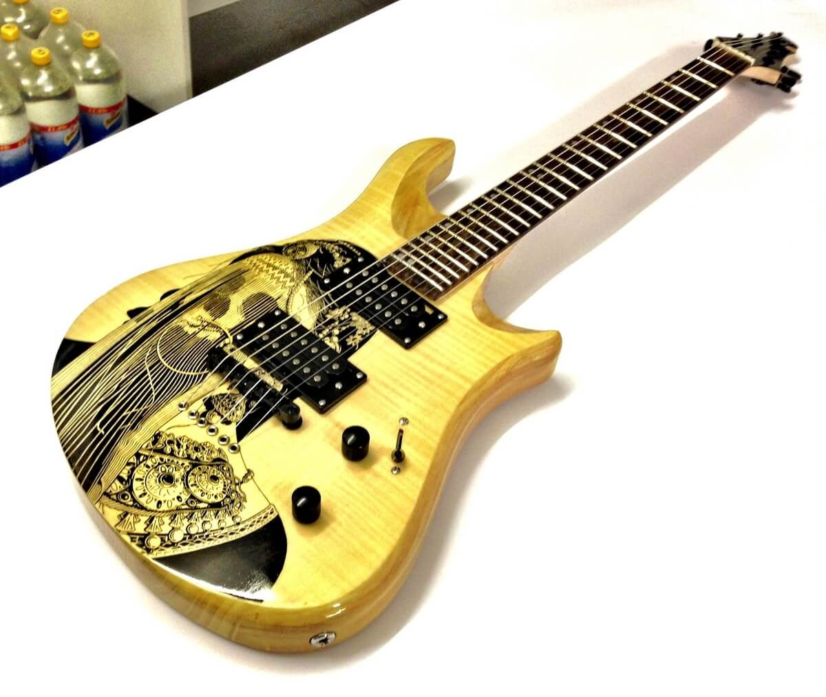 08-Patrick-Fisher-Personalise-your-Guitar-with-Drawings-www-designstack-co