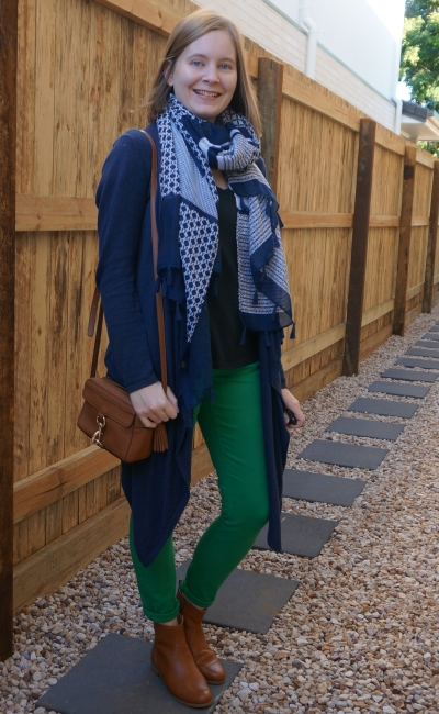 matching tan crossbody bag and ankle boots with navy and green jeans and tee cardigan scarf outfit | away from blue