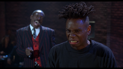 movie - The Nutty Professor -  Dave Chappelle makes an appearance as a stand-up comedian named Reggie Warrington
