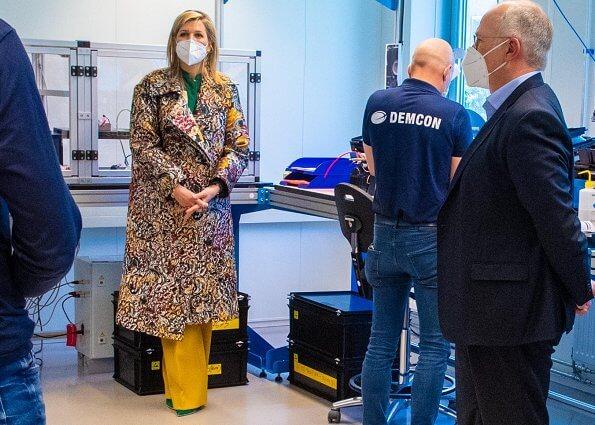 Queen Maxima wore a floral brocade coat by Oscar De La Renta, and a new silk blouse by Zeus + Dione.Valentino tote