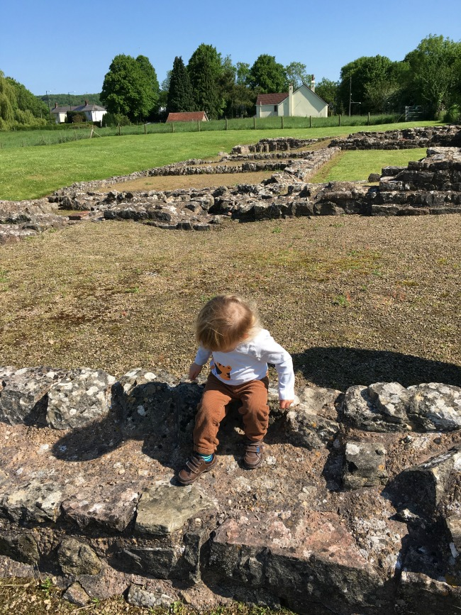 Caerwent Roman Town - A Toddler Explores toddler sitting on roman wall