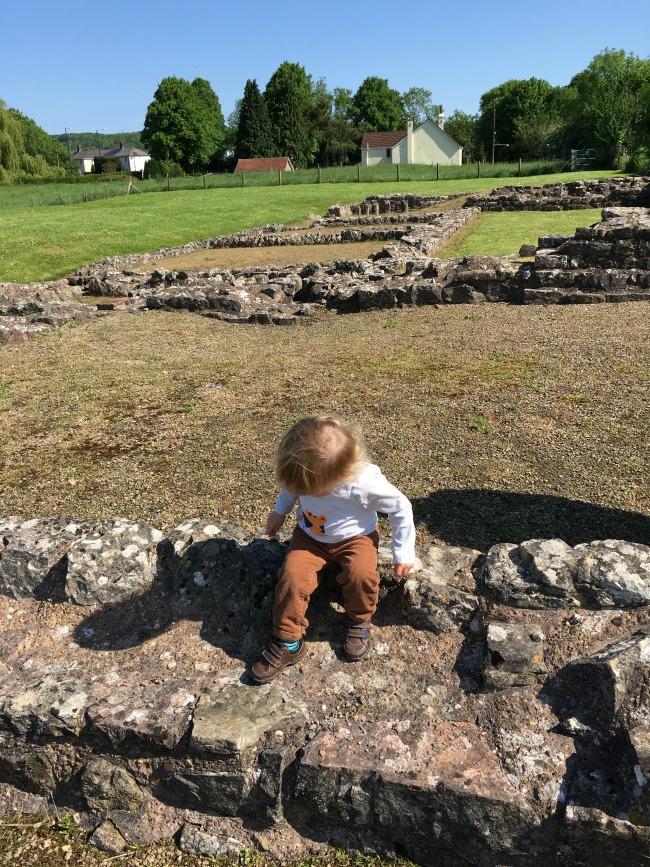 Caerwent Roman Town - A Toddler Explores toddler sitting on roman wall