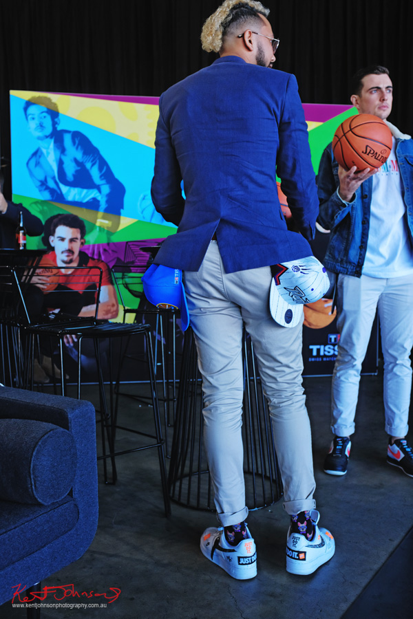 Guests with gifts of basketballs and caps - TISSOT NBA Finals Party Sydney - Photography by Kent Johnson.