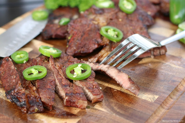 Close up cut up steak with jalapenos