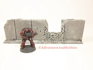 Battle damaged straight concrete wall section T586 with window for 25-28mm war games - UniversalTerrain.com