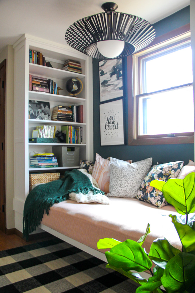 Inspiration from the Bright Green Door. We transformed this space with built ins using Ikea bookshelves. This daybed space is so versitile and provides so much storage.