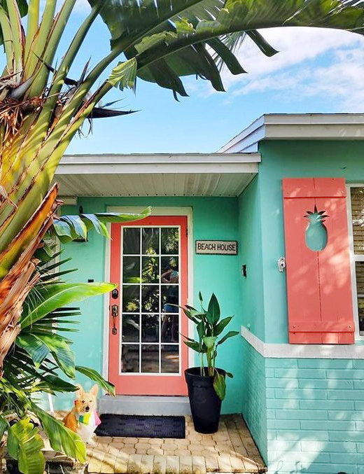 Sea Green Turquoise Beach Bungalow Exterior Color with Coral Red Door and Shutters