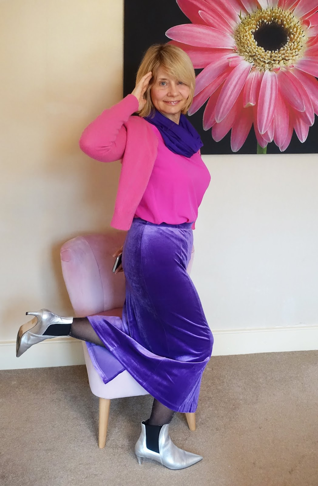 No woman is invisible in purple and fuchsia pink.  Over 50s blogger Gail Hanlon from Is This Mutton in violet velvet skirt and infinity scarf with pink top and cropped cardigan